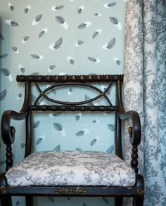 Our wallpapers and fabrics are designed to compliment one another so if you don't fancy having everything matching then why not mix it up?  Here is a great example of our Free Fall wallpaper working with our Camouflage fabric upholstered onto a chair cover and curtains. #feathers #wallpaper #camouflage #leopards #upholstery #furniture #inspiration #interiordesign #homedecor #home #bedroom #design