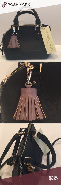 "MADISON WEST BLACK BAG WITH TASSEL This Super cute stylish bags very chic with its brown tassel and gold hardware. Has adjustable length shoulder strap and a beautiful lined inside with one zippered pocket and one open pocket.  Approx 11"" across at widest part  4 1/2"" wide and 7"" High Madison West Bags Shoulder Bags"