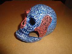 dia de los muertos paper mache skulls