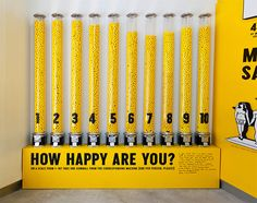 Interactive gum ball participatory exhibit. Vote your happiness level.  The Happy Show by Stefan Sagmeister                                                                                                                                                                                 Mais
