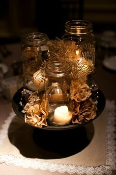 Candle centerpiece with brown bowl and burlap/lace setting.