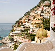 Nestledinto the cliffs of Positano, overlooking the Amalfi Coast, is LeSirenuse - aneighteenth century summer villaturned hotel that has become legendary in this sleepy, romantic village. I love that the traditional details, like the hand paintedtiled floors, the poppy red exterior and