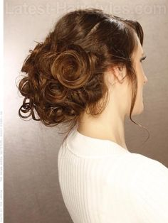 Messy Updo Tousled Brunette Updo with Loose Curls with Long Tendrils and Swirls
