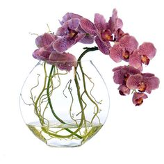 Silk water orchid arrangement in a clear vase.Product: Faux floral arrangementConstruction Material: Silk, plastic, ac...