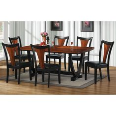 This stylish dining set features a solid wood construction and a handsome two-tone design. The table features a double pedestal base and richly veneered top while the chairs provide both a comfortable and fashionable place to sit.