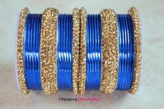 £17 www.NishaDavdra.com 30 pcs Sultan Set: Blue 24 Blue bangles with four citrine edge bangles and two wide bangles to match.   See these in motion below  Makes a perfect party piece and perfect for mix and matching with other bangles to match your outfit perfectly.  The stones are sparkling.   #Bollywoodstyle #bellydancerjewelry #bangles #bracelets #indianfashion #saree #allthingsblue #royalblue #blue #holiday #lehnga #indianbride