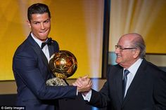 FIFA President Sepp Blatter (right) congratulates Ronaldo on winning the award...