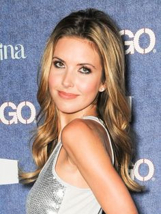 Audrina Patridge rocks a center part, loose ringlets hairstyle