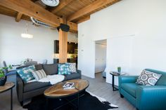 Loft Condo in Winnipeg's Exchange District, featuring century old wood beams, exposed brick walls, and modern finishes.