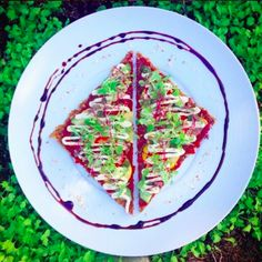 Raw Vegan Flatbread topped with sun-dried tomato sauce (sweetened with dates) and fresh garden oregano and layered with fresh garden basil pesto, marinated veggies, micro-greens  and probiotic cashew cheese.  #thehealingcuisine #raw #vegan #rawpizza #livingfoods #microbiome #probiotic #guthealth #fermentedfoods #microgreens #sprouts #detox #cleanse