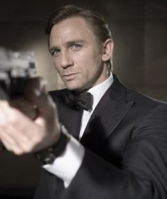 Daniel Craig gets an honorary induction onto Hump Island since he resembles my husband, especially when he plays James Bond. My hubby wears suits and carries guns for real ;)