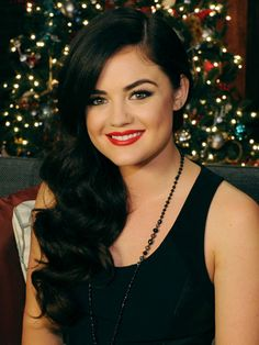Lucy Hale's Retro Waves. Use a 1-inch curling iron, looping each section up and pinning to your head while it's still hot. After your set cools, take the pins out and pull all your hair to one side. Use a boar bristle brush to blend all the curls together, and finish with a flexible hairspray. Don't forget your red lipstick to complete the glam look!