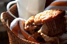 Healthier Morning Glory Muffins  2¼ cups all-purpose flour   2/3 cup sugar   1½ teaspoons baking soda   ½ teaspoon baking powder   1 teaspoon ground cinnamon   ¾ teaspoon salt   ½ cup vegetable oil   3 large eggs   1 (8-ounce) can crushed pineapple (including juices)   1½ cups shredded carrots (2-3 medium)   ½ cup raisins   ½ cup sweetened shredded coconut   ½ cup walnuts