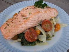 Baked Atlantic Salmon with Roasted Onions and Cherry Tomatoes on Wilted Spinach