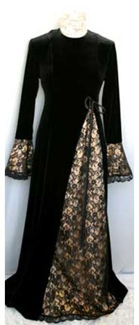 A-line gown gilded in mocha satin with black-lace inverted pleat and bell sleeves; black satin bow.