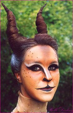 Make your own horns or twist your hair up? This outfit is stunning. If you do end up fastening your hair into horn-like spirals, make sure to use colored hair spray to make them look darker than usual. Then paint your face to look like a deer. If you wear soft leather you will look even more convincing.