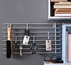 Rail system. I want to do something like this in my hallway for hanging coats, keys, umbrellas, etc.