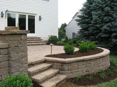 paver patios with lighting | Raised Patio, Seat wall, Landscape planting, and Landscape lighting