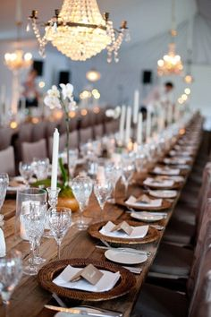 Elegant wedding reception with rustic farm tables and elegant chandeliers. #wedding #table #ideas