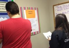 Students pondering the best change to make at Revision Station 1.