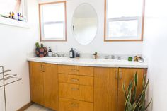The bathroom has double sinks to give the two their own space to get ready in the morning. The pot in the corner was made by Kenesha.