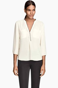 Like the v-neck blouse. A bright color would be nice.