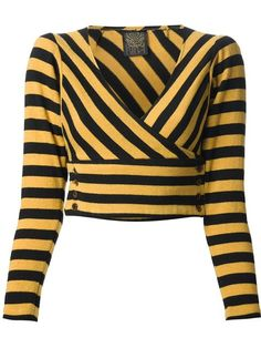 Yellow and black striped trouser suit from Biba featuring a top with a v-neck, a wrap style front, a button fastening, long sleeves and a cropped length. The trousers feature a high waist and a flared leg.