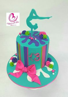 Teal hot pink and purple gymnastics cake bellacakes.nz