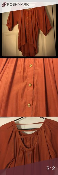 Back cut out top Orange high low top with gold buttons and cut out back Tops Blouses