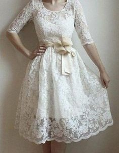 White lace dress with a little POOF. great for the courthouse wedding and or the rehearsal dinner.