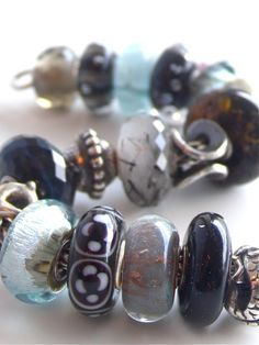 Moody Blue Trollbeads bracelet, featuring Tourmalated Quartz, Unique Amber and Malawi uniques...