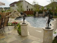 sculptures adorn this Free Form Pool design #freeform #swimmingpool #pools #BarringtonPools