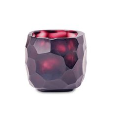 Add a decorative touch to your space with this Yava tealight holder from Amara. Beautifully crafted from mouthblown glass, it features a natural, textured shape that holds the light wonderfully. A wel