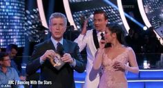 Lochte and his partner, professional dancer Cheryl Burke, react as protesters…
