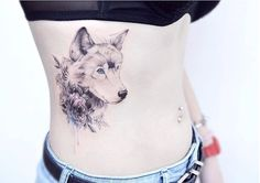 Blue-eyed wolf tattoo by Tattooist Banul