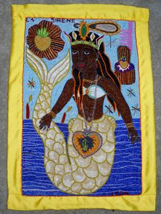"""""""La Sirene"""" flag by Roudy Azor Vodou flags (also called drapos or banners) are traditionally used to decorate the site where a ceremony is held. They are also draped across the backs of ceremony participants so that, as they dance, the shimmer produced by the glittering beads, sequins, and seed pearls will attract a particular lwa or spirit"""
