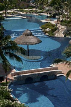 The undulating swimming pool at Fiesta Americana Grand Coral Beach Cancun Resort & Spa Mexico Vacation, Vacation Trips, Vacation Ideas, Cancun Resorts, Girls Getaway, White Sand Beach, Riviera Maya, Resort Spa, Swimming Pools