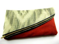Ikat Fold Over Clutch, Aysmmetrical Zipper, Diagonal, Red Suede, Grey, Neutral, Day to Night, For her under 30, Lined, Brass Metal Zipper. $28.00, via Etsy.