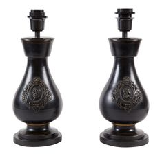 Pair of 19th Century Black Ceramic Lamps by SUSANNE HOLLIS, INC.