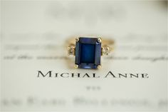 Isn't this a great photo?! Using their wedding invitation as the background!  Michal & Brian Kari Me Photography