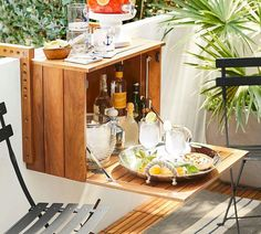 Juliet Balcony Bar Cabinet Even the smallest outdoor spaces can be a garden and entertaining oasis. Small Balcony Design, Tiny Balcony, Small Terrace, Outdoor Balcony, Outdoor Tables, Dining Tables, Outdoor Dining, Small Outdoor Spaces, Small Spaces