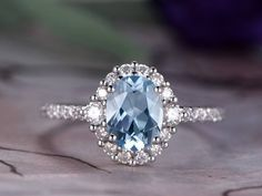 Perfect 1.50 Carat Oval cut Aquamarine and Diamond Halo Engagement Ring in White Gold. Handmadeantique sparkling aquamarine wedding engagement ring showcases total 1.5 carats perfect real blue aquamarine and glittering diamonds and is made in solid 10k White Gold. Break away from the generic look of mass-produced jewelry with this intricate handmade piece.And as always, the order comes with our 30 DAYS FULL REFUND policy  Price: $549.00 USD on Shygems