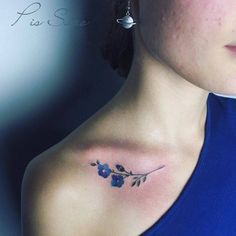 Forget-Me-Not tattoo on the right collarbone.
