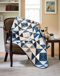 This quilt is absolutely lovely. Our amazing 8-at-a-time triangle-square technique makes construction easy without cutting a single triangle! The Fons & Porter staff show you how to make this quilt in a free video tutorial.  xx