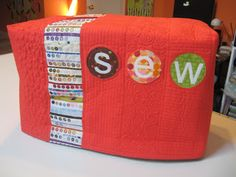 A beautiful, quilted sewing machine cover with selvedges - Studio Dragonfly: Quilts and Projects