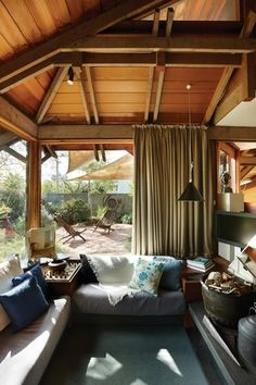 The sunken living room looks out to the courtyard.