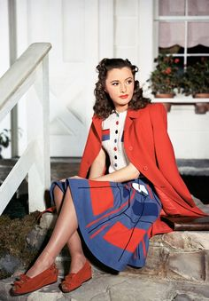 Like the red wedges & some color coordination. Barbara Stanwyck