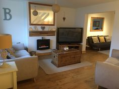 Scandinavian style living room/ wall hung fire ikea skogsta  shelf