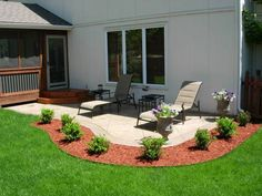 concrete patios surrounded by minimal gardens and lawn make for a relaxing outdoor area. #landscaping #gardens #patios