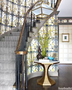 Phillip Jeffries' Rivets wall covering in the back, which in turn echoes the gold tones of the fabric, Bunny Williams' classic Hourglass table and a custom light fixture. Color in House Beautiful with Lindsey Coral Harper